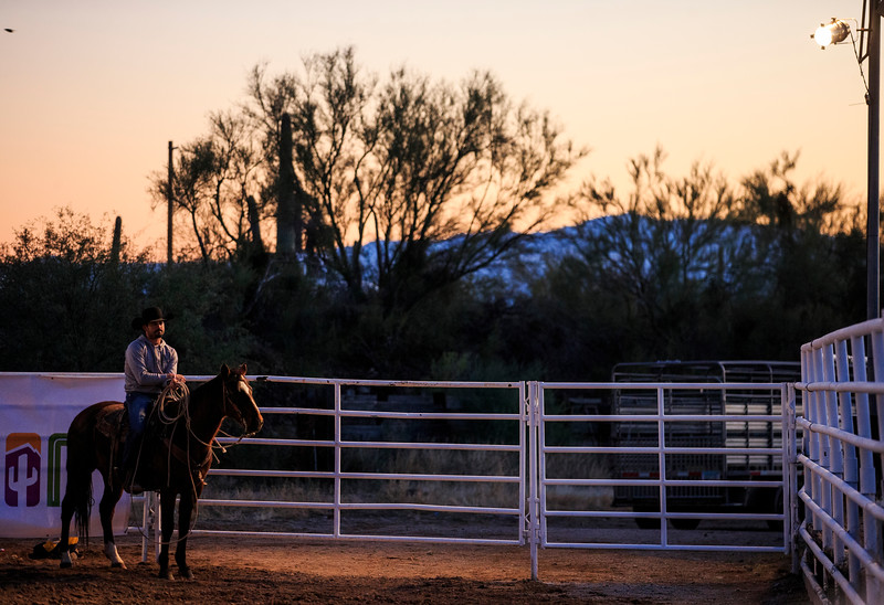 An cowboy waits as the Wyoming Cowboys and Georgia State Panthers arrive to watch rodeo and have dinner Sunday, Dec. 29, 2019 at Old Tucson in Tucson. Old Tucson, a movie studio and theme park hosts teams before the Arizona bowl. Nadav Soroker/Wyoming Tribune Eagle