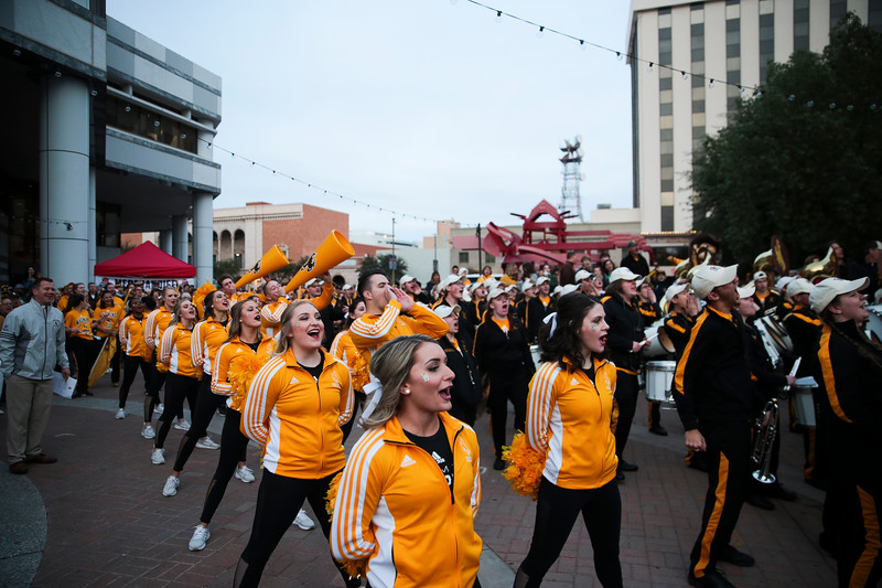 The Wyoming Cheerleaders shout  at the pep rally Monday, Dec. 30, 2019 in downtown Tucson. University of Wyoming Cowboys fans joined the Western Thunder Marching band and spirit squad in a pep rally against the Georgia State University Panthers fans and band. Nadav Soroker/Wyoming Tribune Eagle
