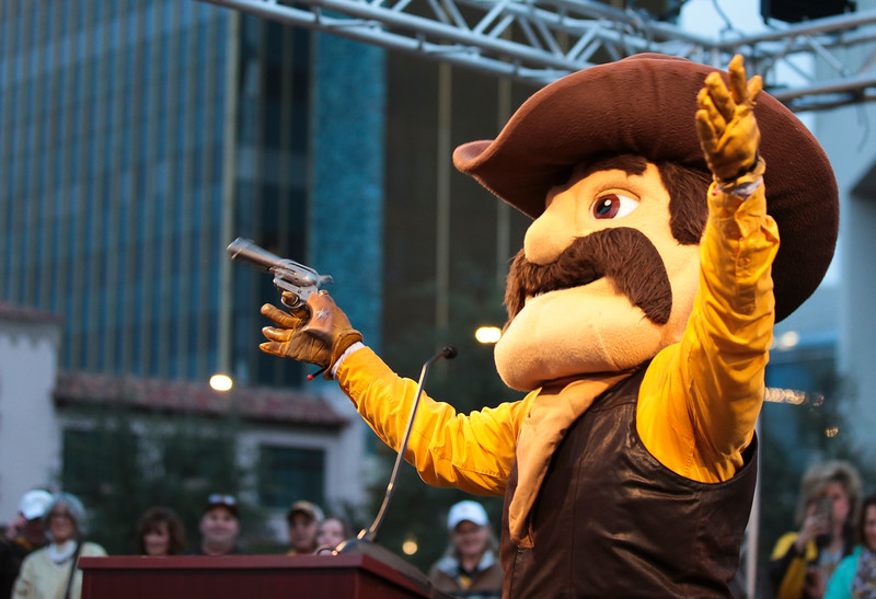 Pistol Pete waves to the crowd from the podium Monday, Dec. 30, 2019 in downtown Tucson. University of Wyoming Cowboys fans joined the Western Thunder Marching band and spirit squad in a pep rally against the Georgia State University Panthers fans and band. Nadav Soroker/Wyoming Tribune Eagle