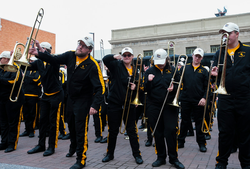 University of Wyoming Cowboys fans joined the Western Thunder Marching band and spirit squad in a pep rally against the Georgia State University Panthers fans and band Monday, Dec. 30, 2019 in downtown Tucson. Nadav Soroker/Wyoming Tribune Eagle