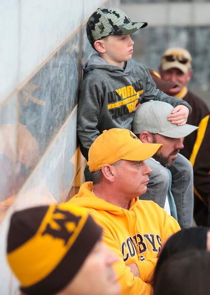 Hudson Colling, 6, sits on Andrew Colling's shoulder as they watch the pep rally next to Ed Telgenhoff Monday, Dec. 30, 2019 in downtown Tucson. University of Wyoming Cowboys fans joined the Western Thunder Marching band and spirit squad in a pep rally against the Georgia State University Panthers fans and band. Nadav Soroker/Wyoming Tribune Eagle