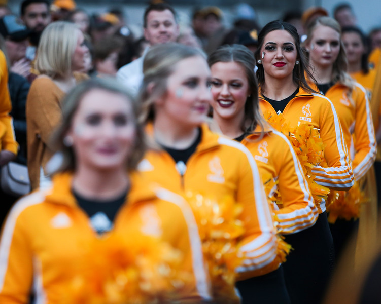 Wyoming Cheerleader Allie Telgenhoff and the rest of the squad listen to speeches by Wyoming athletic director Tom  Burman at the pep rally Monday, Dec. 30, 2019 in downtown Tucson. University of Wyoming Cowboys fans joined the Western Thunder Marching band and spirit squad in a pep rally against the Georgia State University Panthers fans and band. Nadav Soroker/Wyoming Tribune Eagle