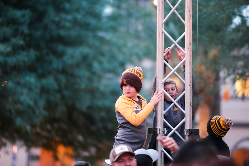 Lane Ramsey, 9, Jaxson Enevoldsen, 8, and Beckett Enevoldsen, 4, climb up to a higher vantage point to play at the pep rally Monday, Dec. 30, 2019 in downtown Tucson. University of Wyoming Cowboys fans joined the Western Thunder Marching band and spirit squad in a pep rally against the Georgia State University Panthers fans and band. Nadav Soroker/Wyoming Tribune Eagle