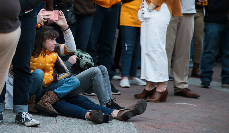 Sophie Colling, 8, watches the Wyoming Cheerleaders at the pep rally Monday, Dec. 30, 2019 in downtown Tucson. University of Wyoming Cowboys fans joined the Western Thunder Marching band and spirit squad in a pep rally against the Georgia State University Panthers fans and band. Nadav Soroker/Wyoming Tribune Eagle