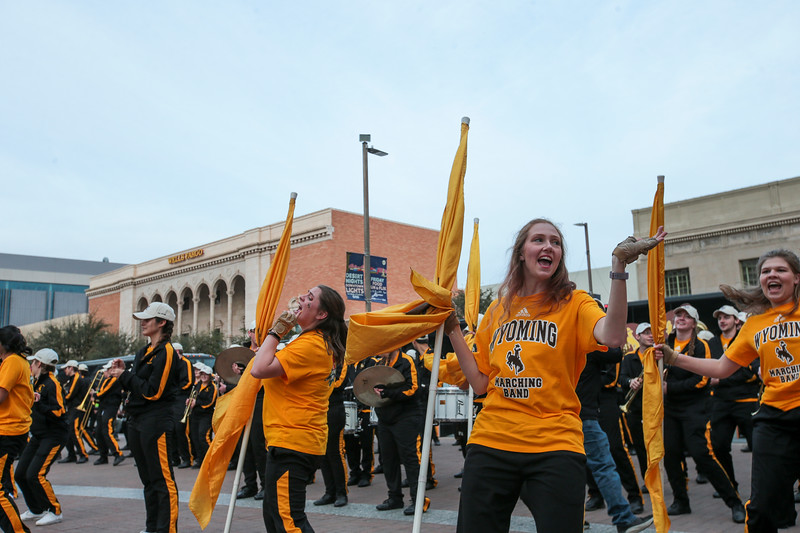 The Western Thunder Marching Band performs as they arrive at the pep rally Monday, Dec. 30, 2019 in downtown Tucson. University of Wyoming Cowboys fans joined the Western Thunder Marching band and spirit squad in a pep rally against the Georgia State University Panthers fans and band. Nadav Soroker/Wyoming Tribune Eagle