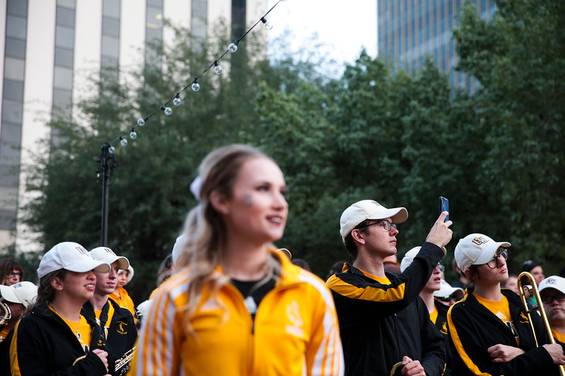 A member of the Western Thunder marching band takes a video of the Georgia State band Monday, Dec. 30, 2019 in downtown Tucson. University of Wyoming Cowboys fans joined the Western Thunder Marching band and spirit squad in a pep rally against the Georgia State University Panthers fans and band. Nadav Soroker/Wyoming Tribune Eagle