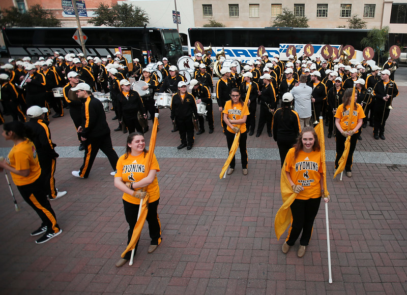 The Western Thunder Marching Band forms up to enter the pep rally Monday, Dec. 30, 2019 in downtown Tucson. University of Wyoming Cowboys fans joined the Western Thunder Marching band and spirit squad in a pep rally against the Georgia State University Panthers fans and band. Nadav Soroker/Wyoming Tribune Eagle