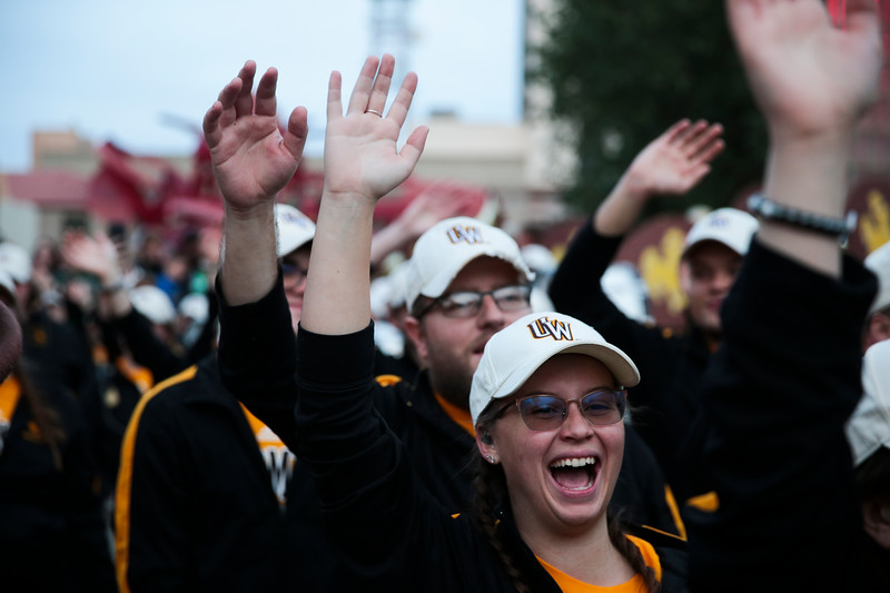 "Members of the Western Thunder Marching Band cheer and wave their hands in time to the Georgia State Marching Band's performance of ""Georgia on my Mind"" at the pep rally Monday, Dec. 30, 2019 in downtown Tucson. University of Wyoming Cowboys fans joined the Western Thunder Marching band and spirit squad in a pep rally against the Georgia State University Panthers fans and band. Nadav Soroker/Wyoming Tribune Eagle"