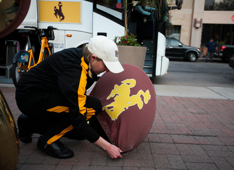 A member of the Western Thunder marching band adjusts a cover on their tuba Monday, Dec. 30, 2019 in downtown Tucson. University of Wyoming Cowboys fans joined the Western Thunder Marching band and spirit squad in a pep rally against the Georgia State University Panthers fans and band. Nadav Soroker/Wyoming Tribune Eagle