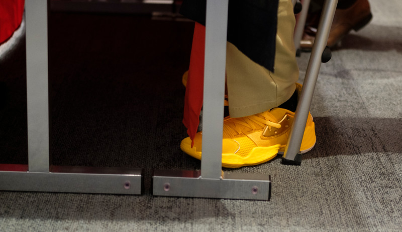 Wyoming Cowboys wide receiver Austin Conway's gold shoes under the table at a pre-game press conference Monday, Dec. 30, 2019 at the AC Marriot in Tucson. Nadav Soroker/Wyoming Tribune Eagle