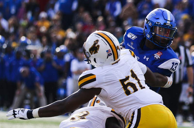 Wyoming defensive end Solomon Byrd (51) gets an arm around Georgia State quarterback Dan Ellington (13) as he attempts a run Tuesday, Dec. 31, 2019 at the University of Arizona. The Wyoming Cowboys lead the Georgia State Panthers 24-10 at halftime in the Arizona Bowl. Nadav Soroker/Wyoming Tribune Eagle