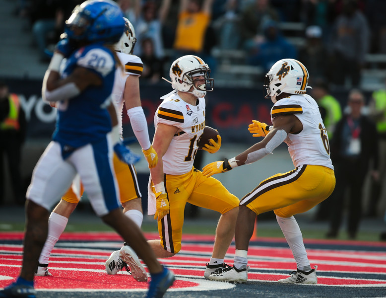 Wyoming Ayden Eberhardt (19) celebrates a touchdown Tuesday, Dec. 31, 2019 at the University of Arizona. The Wyoming Cowboys lead the Georgia State Panthers 24-10 at halftime in the Arizona Bowl. Nadav Soroker/Wyoming Tribune Eagle
