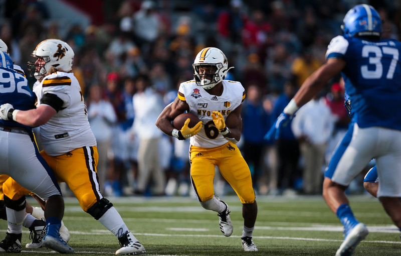 Wyoming running back Xazavian Valladay (6) runs through a gap Tuesday, Dec. 31, 2019 at the University of Arizona. The Wyoming Cowboys lead the Georgia State Panthers 24-10 at halftime in the Arizona Bowl. Nadav Soroker/Wyoming Tribune Eagle