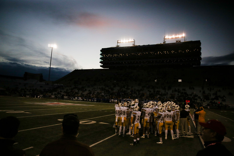 The Wyoming Cowboys huddle on the field as the sun sets behind the stadium Tuesday, Dec. 31, 2019 at the University of Arizona. The Wyoming Cowboys defeat the Georgia State Panthers 38-17 to win the Arizona Bowl. Nadav Soroker/Wyoming Tribune Eagle