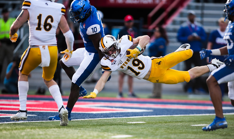 Wyoming wide receiver Ayden Eberhardt (19) dives for a touchdown after catching a scrambling pass from quarterback Levi Williams (15) Tuesday, Dec. 31, 2019 at the University of Arizona. The Wyoming Cowboys lead the Georgia State Panthers 24-10 at halftime in the Arizona Bowl. Nadav Soroker/Wyoming Tribune Eagle