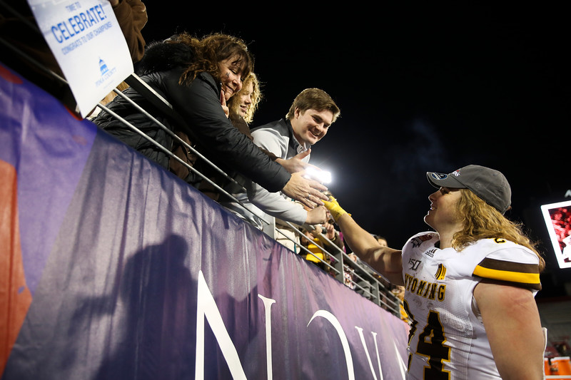 Wyoming running back Brett Brenton (24) says hello to fans after the Cowboys win the Arizona Bowl Tuesday, Dec. 31, 2019 at the University of Arizona. The Wyoming Cowboys defeat the Georgia State Panthers 38-17 to win the Arizona Bowl. Nadav Soroker/Wyoming Tribune Eagle