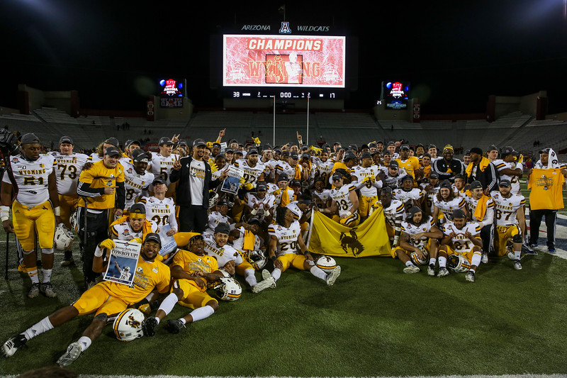 The Cowboys pose for a photo with the Arizona Bowl trophy Tuesday, Dec. 31, 2019 at the University of Arizona. The Wyoming Cowboys defeat the Georgia State Panthers 38-17 to win the Arizona Bowl. Nadav Soroker/Wyoming Tribune Eagle