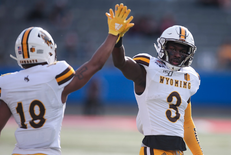 Wyoming safety Alijah Halliburton (3) high-fives quar Tuesday, Dec. 31, 2019 at the University of Arizona. The Wyoming Cowboys lead the Georgia State Panthers 24-10 at halftime in the Arizona Bowl. Nadav Soroker/Wyoming Tribune Eagle