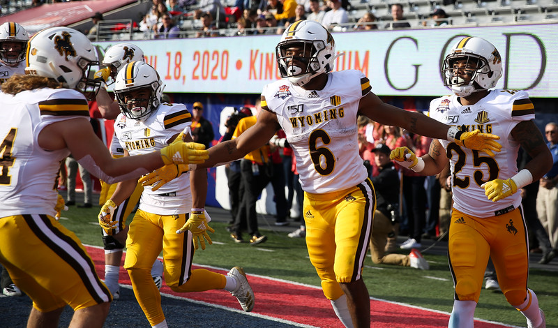 Wyoming running back Xazavian Valladay (6) celebrates a touchdown Tuesday, Dec. 31, 2019 at the University of Arizona. The Wyoming Cowboys lead the Georgia State Panthers 24-10 at halftime in the Arizona Bowl. Nadav Soroker/Wyoming Tribune Eagle