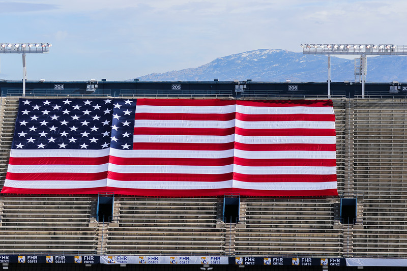 A large American Flag is stretched across the upper stands of Arizona Stadium before the Nova Home Loans Arizona Bowl starts Tuesday, Dec. 31, 2019 at the University of Arizona. Wyoming Fans fill the Arizona Bowl tailgate area before the Cowboys take on the Georgia State University Panthers. Nadav Soroker/Wyoming Tribune Eagle