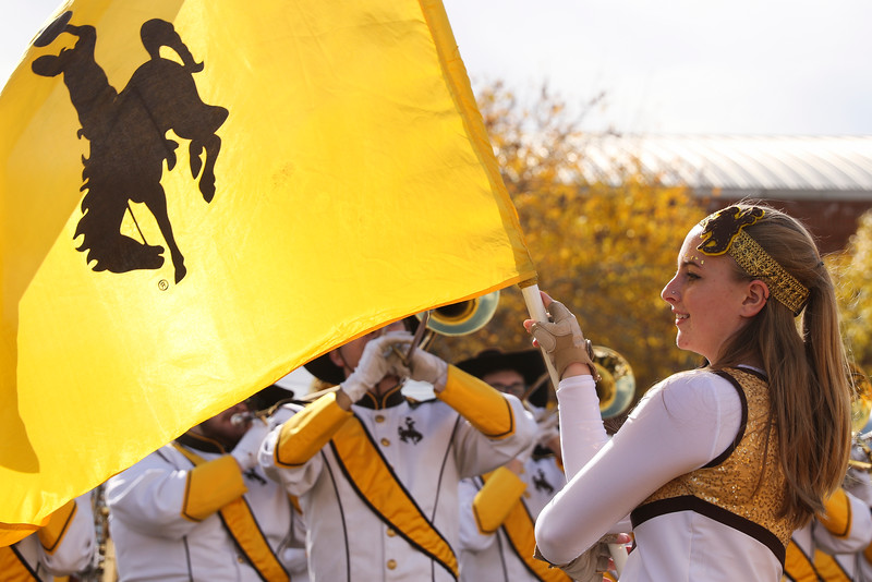 Western Thunder member Sasha Bentley twirls the Steamboat flag during the battle of the bands in the tailgate area Tuesday, Dec. 31, 2019 at the University of Arizona. Wyoming Fans fill the Arizona Bowl tailgate area before the Cowboys take on the Georgia State University Panthers. Nadav Soroker/Wyoming Tribune Eagle