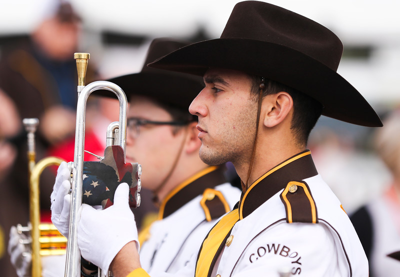 A member of the Western Thunder marching band stands at attention before a battle of the bands in the tailgate area Tuesday, Dec. 31, 2019 at the University of Arizona. Wyoming Fans fill the Arizona Bowl tailgate area before the Cowboys take on the Georgia State University Panthers. Nadav Soroker/Wyoming Tribune Eagle