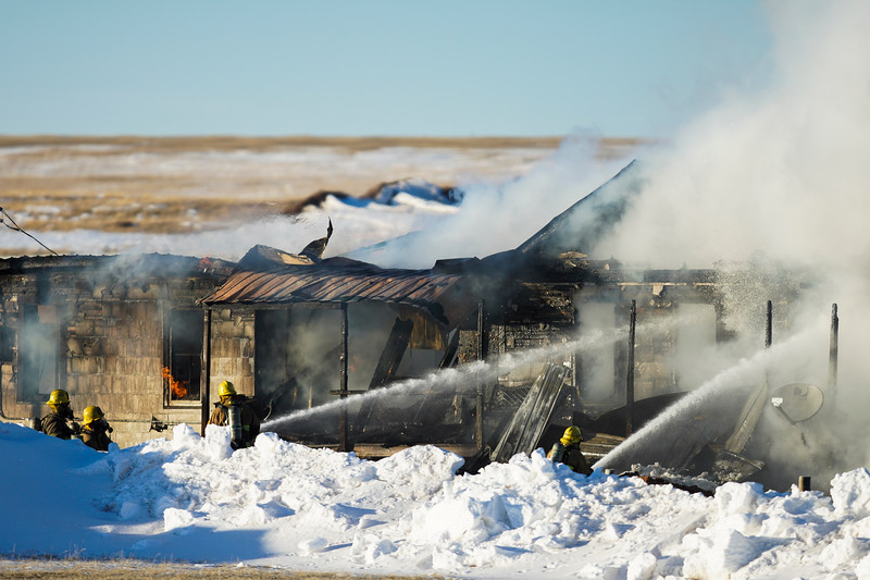 Firefighters put water on a house fire at 2354 County Road 124 Tuesday, Jan. 7, 2020 north of Cheyene. Nobody was in the fire when it started and investigators will be looking into the cause of the fire, LCFD2 operations chief Manny Muzquiz said. Laramie County Fire District 2 was aided by Laramie County Fire District 1, F.E. Warren Air Force Base, Wyoming Air National Guard, Cheyenne Fire Rescue, AMR and Laramie County Sheriff's Department. Nadav Soroker/Wyoming Tribune Eagle