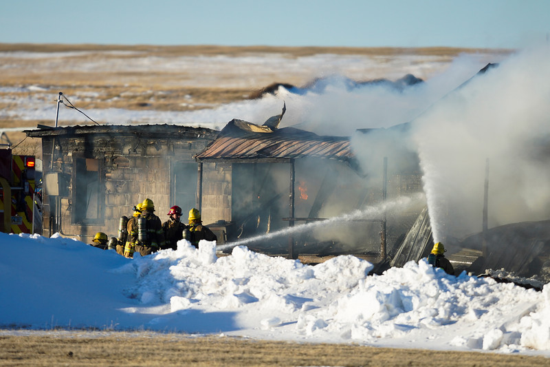 Laramie County Fire District 2 and other local agencies respond to a house fire at 2354 County Road 124 Tuesday, Jan. 7, 2020 north of Cheyene. Nobody was in the fire when it started and investigators will be looking into the cause of the fire, LCFD2 operations chief Manny Muzquiz said. Nadav Soroker/Wyoming Tribune Eagle
