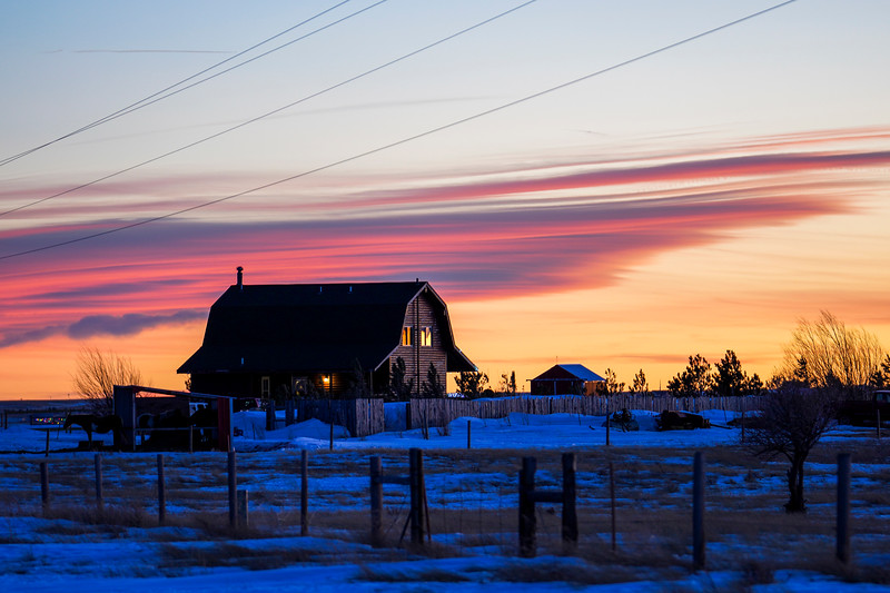 The sunset lights up the sky behind a ranch house on County Road 124 Tuesday, Jan. 7, 2020 north of Cheyene. Strong winds scoured the area with gusts recorded up to 61 mph, which are also expected Wednesday according to the National Weather Service. Nadav Soroker/Wyoming Tribune Eagle