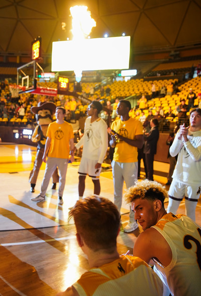 Wyoming guard Hunter Maldonado (24) looks at his teammate Wyoming guard Kenny Foster (22) before being introduced to the court Wednesday, Jan. 8, 2020 in Arena-auditorium. The University of Wyoming basketball team loses to San Diego State 72-52. Nadav Soroker/Laramie Boomerang