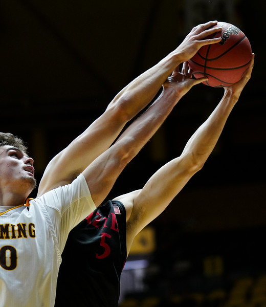 Wyoming forward Hunter Thompson (10) attempts to get a rebound from San Diego State forward Yanni Wetzell (5) Wednesday, Jan. 8, 2020 in Arena-auditorium. The University of Wyoming basketball team loses to San Diego State 72-52. Nadav Soroker/Laramie Boomerang