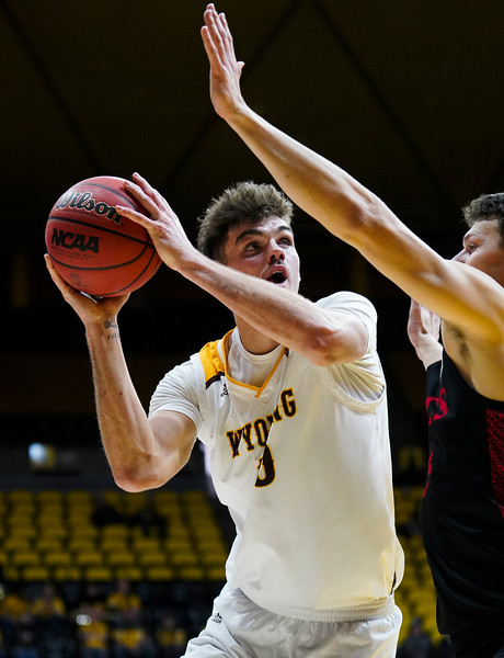 Wyoming forward Hunter Thompson (10) edges around a guard for a shot Wednesday, Jan. 8, 2020 in Arena-auditorium. The University of Wyoming basketball team loses to San Diego State 72-52. Nadav Soroker/Laramie Boomerang