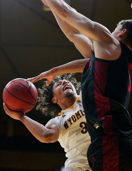 Wyoming guard Kwane Marble II (3) attempts a shot through San Diego State forward Yanni Wetzell (5) Wednesday, Jan. 8, 2020 in Arena-auditorium. The University of Wyoming basketball team loses to San Diego State 72-52. Nadav Soroker/Laramie Boomerang