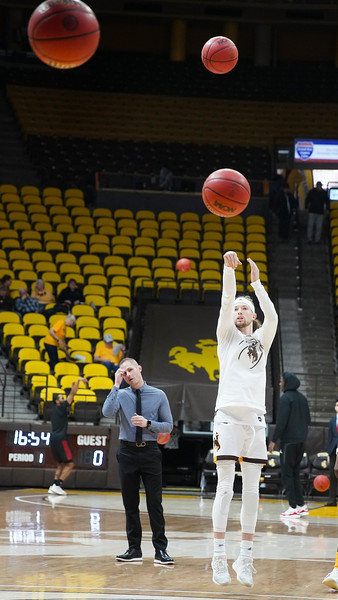 Wyoming guard Jake Hendricks (0) practices three-point shots during warm-ups Wednesday, Jan. 8, 2020 in Arena-auditorium. The University of Wyoming basketball team loses to San Diego State 72-52. Nadav Soroker/Laramie Boomerang