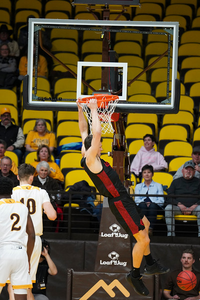San Diego State forward Yanni Wetzell (5) hangs from the rim after slamming in a dunk Wednesday, Jan. 8, 2020 in Arena-auditorium. The University of Wyoming basketball team loses to San Diego State 72-52. Nadav Soroker/Laramie Boomerang