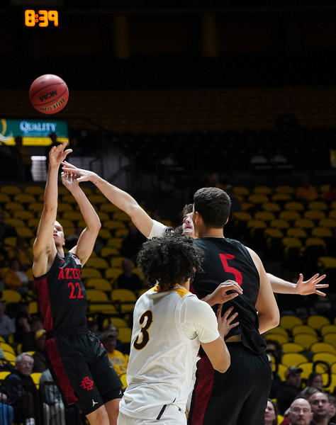 San Diego State guard Malachi Flynn (22) attempts a shot past Wyoming forward Hunter Thompson (10) Wednesday, Jan. 8, 2020 in Arena-auditorium. The University of Wyoming basketball team loses to San Diego State 72-52. Nadav Soroker/Laramie Boomerang