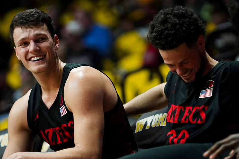 San Diego State forward Yanni Wetzell (5) and San Diego State guard Jordan Schakel (20) laugh on the bench after a teammate accidentally steps out of bounds while not under pressure Wednesday, Jan. 8, 2020 in Arena-auditorium. The University of Wyoming basketball team loses to San Diego State 72-52. Nadav Soroker/Laramie Boomerang