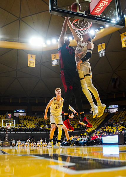 San Diego State forward Nolan Narain (12) attempts a basket over Wyoming guard Jake Hendricks (0) Wednesday, Jan. 8, 2020 in Arena-auditorium. The University of Wyoming basketball team loses to San Diego State 72-52. Nadav Soroker/Laramie Boomerang