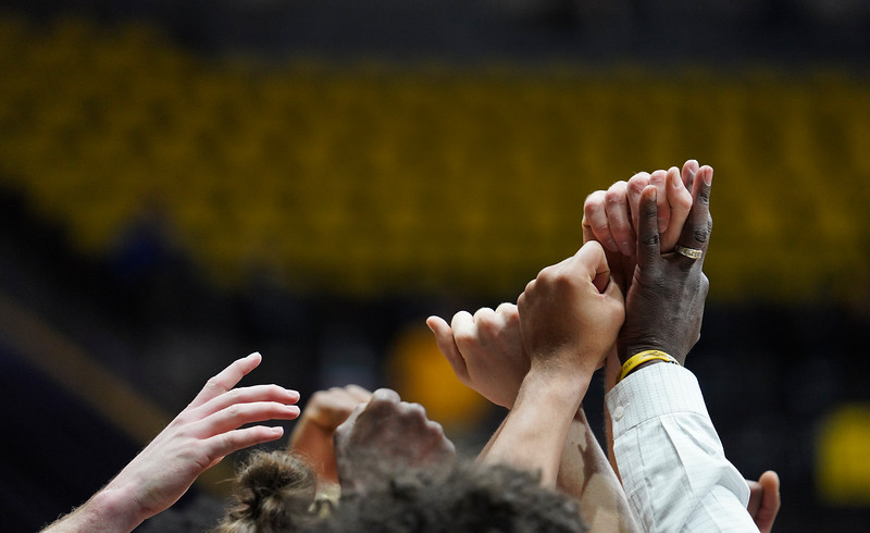 The Wyoming team raises their fists at the end of a time-out Wednesday, Jan. 8, 2020 in Arena-auditorium. The University of Wyoming basketball team loses to San Diego State 72-52. Nadav Soroker/Laramie Boomerang