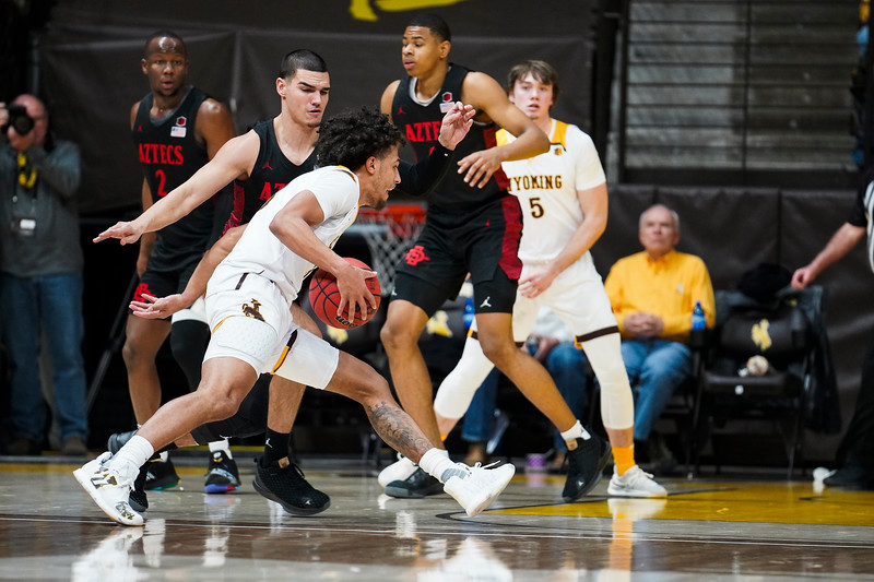 Wyoming guard Kwane Marble II (3) drives around San Diego State guard Caleb Giordano (13) to get under the basket Wednesday, Jan. 8, 2020 in Arena-auditorium. The University of Wyoming basketball team loses to San Diego State 72-52. Nadav Soroker/Laramie Boomerang