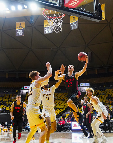 San Diego State guard Malachi Flynn (22) drives up under the basket Wednesday, Jan. 8, 2020 in Arena-auditorium. The University of Wyoming basketball team loses to San Diego State 72-52. Nadav Soroker/Laramie Boomerang