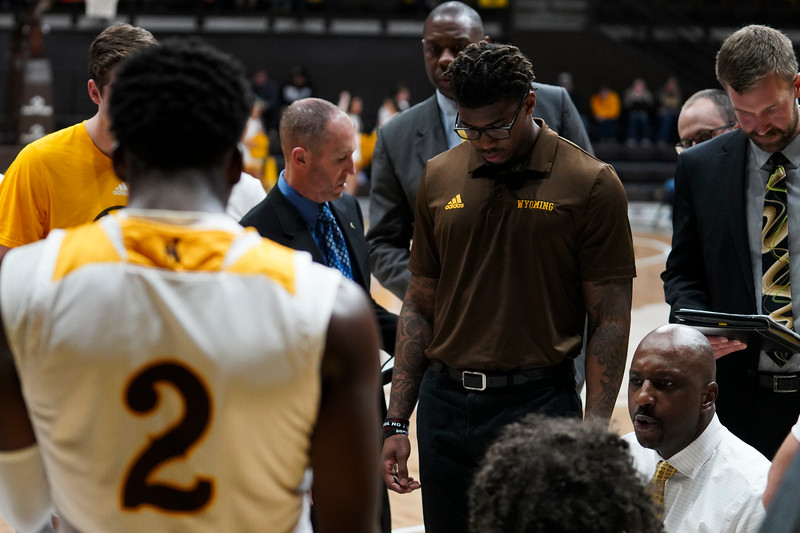 Wyoming head coach Allen Edwards, lower right, instructs the team during a time-out Wednesday, Jan. 8, 2020 in Arena-auditorium. The University of Wyoming basketball team loses to San Diego State 72-52. Nadav Soroker/Laramie Boomerang