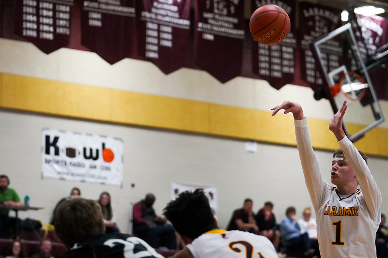 Laramie High junior Christian Mickelson attempts a free throw Thursday, Jan. 9, 2020 at the Laramie High School Gymnasium. The Plainsmen defeat Green River 52-49 in the first day of the Taco John's Invitation. Nadav Soroker/Laramie Boomerang