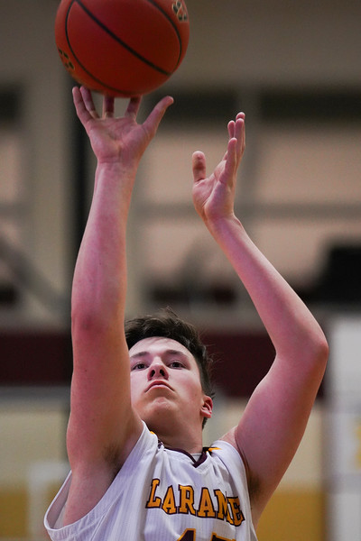Laramie High sophomore Trey Enzi attempts a free throw Thursday, Jan. 9, 2020 at the Laramie High School Gymnasium. The Plainsmen defeat Green River 52-49 in the first day of the Taco John's Invitation. Nadav Soroker/Laramie Boomerang