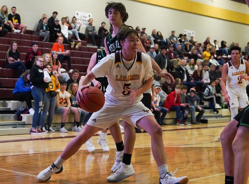 Laramie High junior Garrett Dodd fights his way in under the basket Thursday, Jan. 9, 2020 at the Laramie High School Gymnasium. The Plainsmen defeat Green River 52-49 in the first day of the Taco John's Invitation. Nadav Soroker/Laramie Boomerang