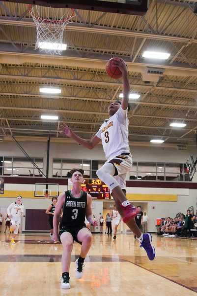 Laramie High senior Noah Valdez jumps for a breakaway basket Thursday, Jan. 9, 2020 at the Laramie High School Gymnasium. The Plainsmen defeat Green River 52-49 in the first day of the Taco John's Invitation. Nadav Soroker/Laramie Boomerang