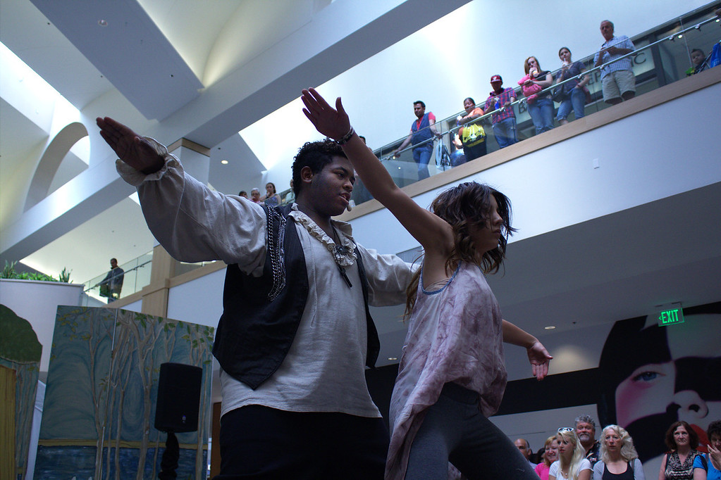 SRJC Spring Fashion Show Master of Ceremonies Tyler Rich and Shardai Mitchell kick off the Spring Fashion show with a quick dance number to introduce the theme, Spellbound, at the Santa Rosa Mall, April 28, 2013. The show highlighted both the heros and villians of popular fairytales, with styles ranging from their classical outfits to modern casual, semi-formal, formal and custom designed outfits from SRJC designers.