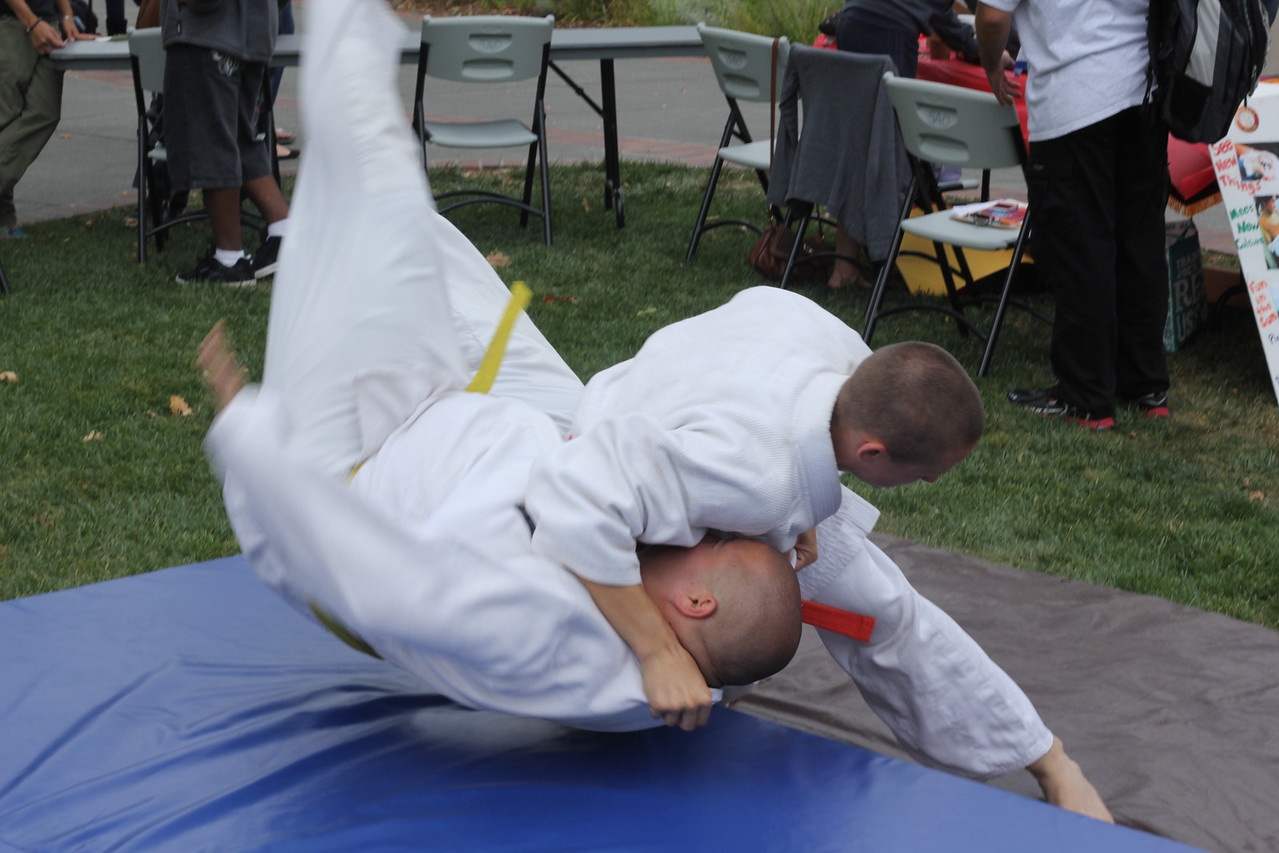 J Olsa gets thrown to the mat by Kelsey Claybrook at a Judo Demonstration in the SRJC Quad.