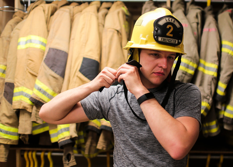 Yevgeniy Sokolov tries on his new helmet during the first night of the nine week firefighter academy on Monday, September 9, 2019 at Laramie County Fire District 2 headquarters. Sokolov and the other trainees fitted out for bunker gear the first night as part of orientation. Nadav Soroker/Wyoming Tribune Eagle