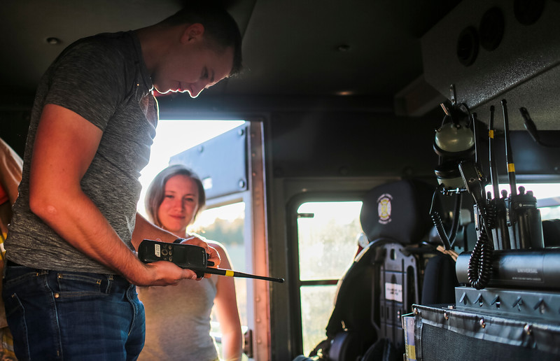 Yevgeniy Sokolov and Ashley Sokolov, his wife, explore the back of an engine during the family portion of the orientation night of the firefighter academy on Monday, September 9, 2019 at Laramie County Fire District 2 headquarters. The fire academy invites family members to attend the introduction so they can see what their spouses, parents and loved ones will be doing for the next few months. Nadav Soroker/Wyoming Tribune Eagle
